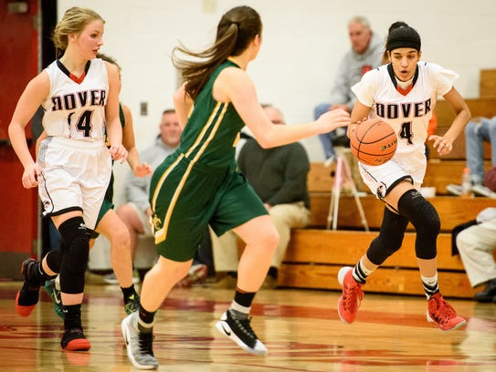 Dover's Rayah Fink (4) dribbles down court against