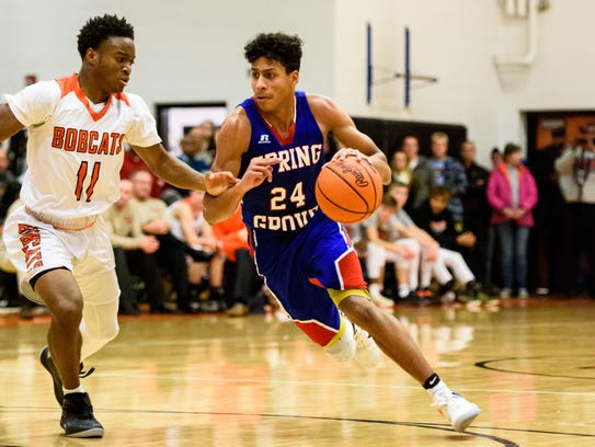 Spring Grove's Eli Brooks (24) dribbles around Northeastern's
