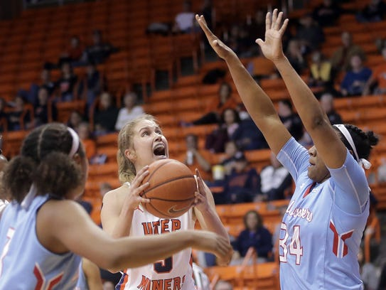 UTEP's Zuzanna Puc looks for the basket while defended