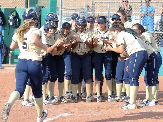 Coronado's Abigale Carney is met at home plate by her