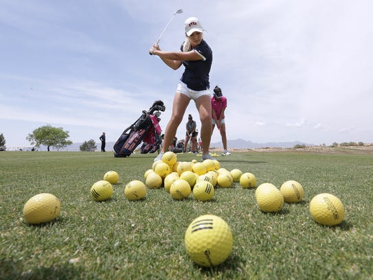 UTEP's Lily Downs hits balls on the driving range Thurday