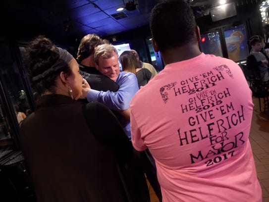 York city mayoral candidate Michael Helfrich is embraced