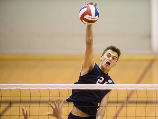 In this file photo, Dallastown's Jake Bixler (21) eyes a kill attempt against Lower Dauphin in the District 3 Class 3A volleyball semifinals at Central York on Monday, May 22, 2017.