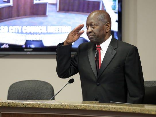 El Paso City Rep. Carl Robinson salutes during his