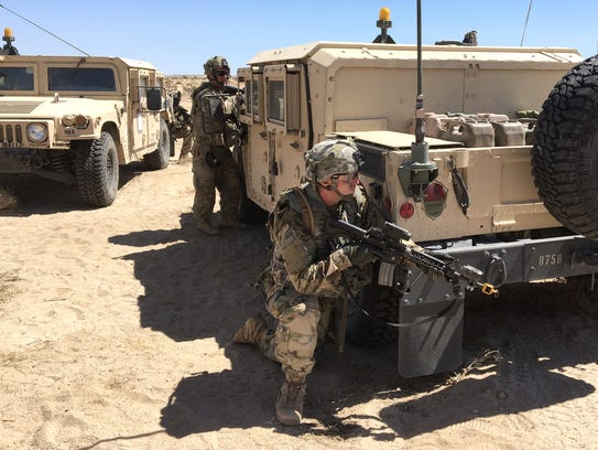 Soldiers from 2nd Brigade react to an enemy attack from the opposing force at the National Training Center at Fort Irwin, Calif., in August. The rotation was the culminating training event as the brigade got ready to deploy to the Middle East this fall.