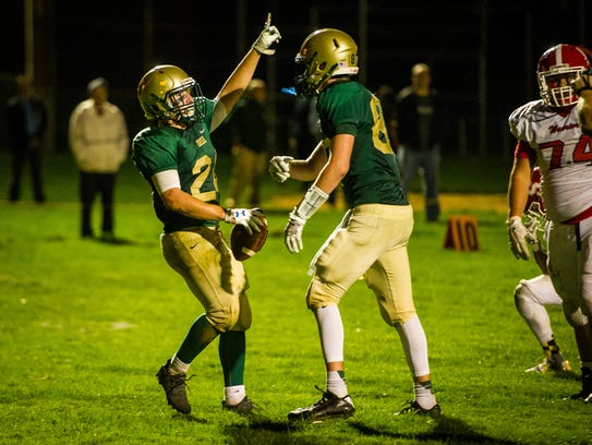 York Catholic's Andrew Snelbaker (24) celebrates a