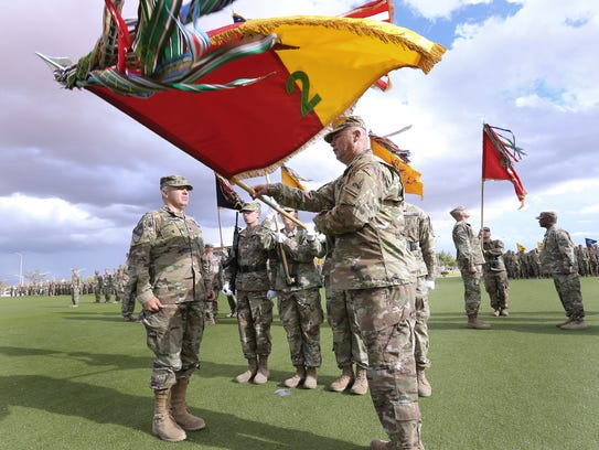The command team from 2nd Brigade cases the unit's colors as it gets ready to deploy to the Middle East.