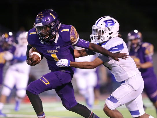 Burges running back Quan McNeil breaks away from Bowie