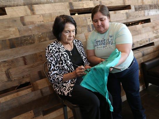 Civil rights icon Dolores Huerta signs a Barrio Duranguito