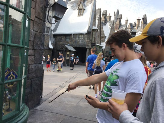Guests enjoy the magic with an interactive wand.