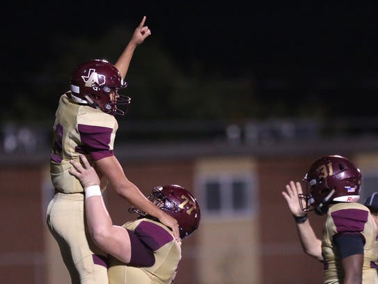 Andress wins district Friday against Chapin 48-22.