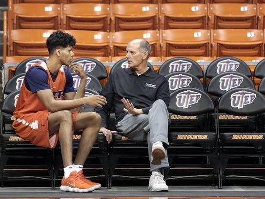 UTEP interim head coach Phil Johnson talks with UTEP junior forward prior to a practice at the Don Haskins Center.