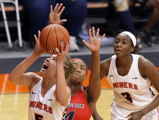 UTEP's Zuzanna Puc goes to the basket covered by UNM's