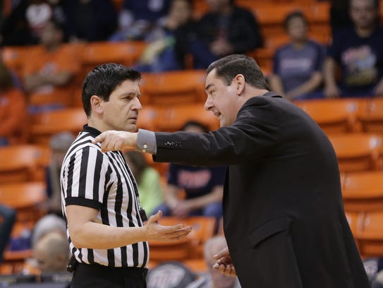 UTEP coach Kevin Baker talks to an official during