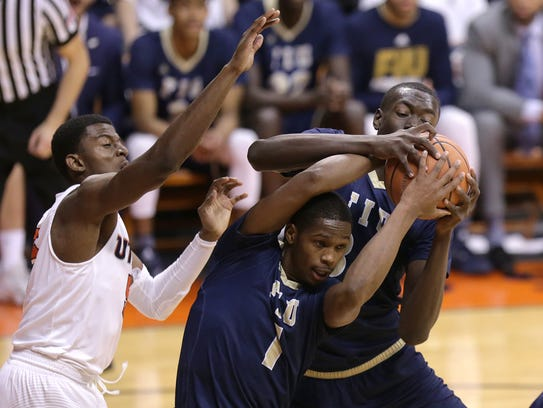 FIU's Osasumwen Osaghae, right, and Isaiah Banks fight