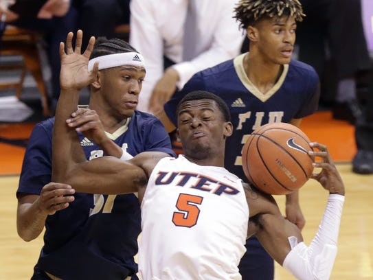 UTEP's Trey Wade tries to maintain possession after