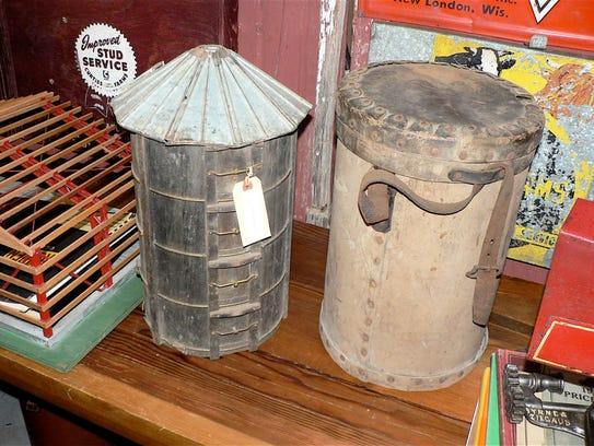 A wooden silo model and its carrying case.
