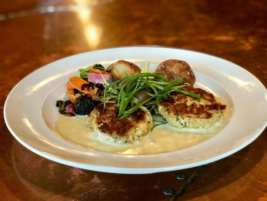 Crab cakes are part of the seasonal soft-shell crab