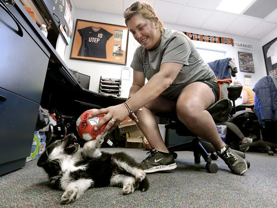 UTEP assistant soccer coach Jessie Pettit plays with