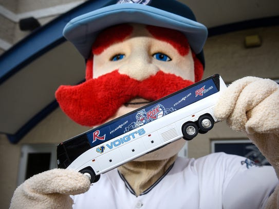 St. Cloud Rox mascot Chisel holds a bus bank that will