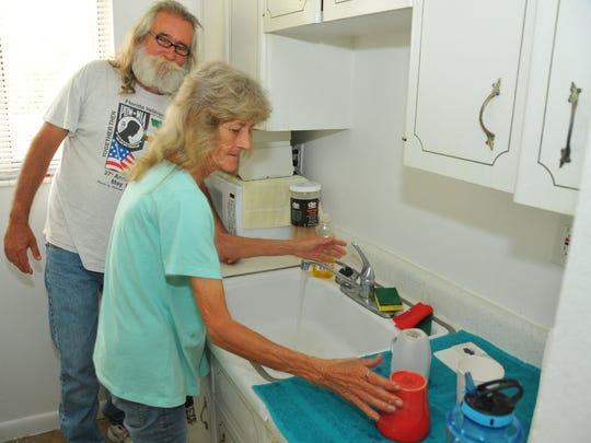 Russell and Kelly in their small, immaculate kitchen. Kelly and Russell Marquis had been homeless on and of for over 15 years. With the help of Dorothy Walsh with Volunteers of America,  they moved into a nice one bedroom apartment in Melbourne in March. Russell is a Vietnam vet.