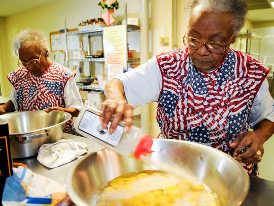 Love Kitchen founders Ellen Turner, left, and her sister Helen Ashe prepare breakfast Wednesday, Oct 14, 2009 in East Knoxville.