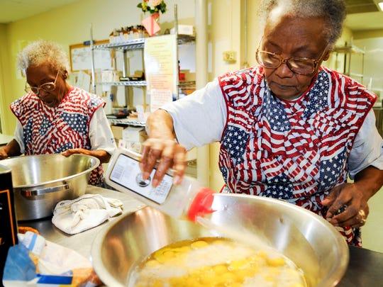 Love Kitchen founders Ellen Turner, left, and her sister Helen Ashe prepare breakfast in 2009.