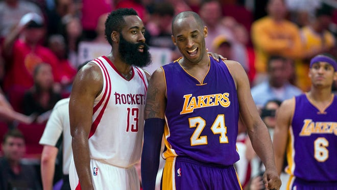 Houston Rockets guard James Harden (13) jokes with Los Angeles Lakers forward Kobe Bryant (24) during the second half at the Toyota Center.