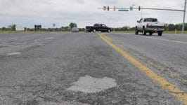 In this 2010 file photo, pothole patches and a pot hole litter the roadway on Beaglin Park Drive near Old Ocean City Road.