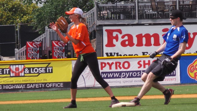 Florida Georgia Line singer Brian Kelley, right, is safe at second as country singer Sara Darling waits for the throw from the outfield. The two were playing in City of Hope's celebrity softball game in Nashville on June 7, 2014.