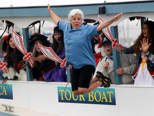 Michael Zamora/Caller-TimesMayor Nelda Martinez leaps off the side of the boat Thursday, April 25, 2013 as Buc Days King and Queen contestants cheer her on during the dunking of the mayor event along the Corpus Christi Marina. The event ceremonially signals the pirate take over of the city, kicking off the Buc Days celebration in Corpus Christi.