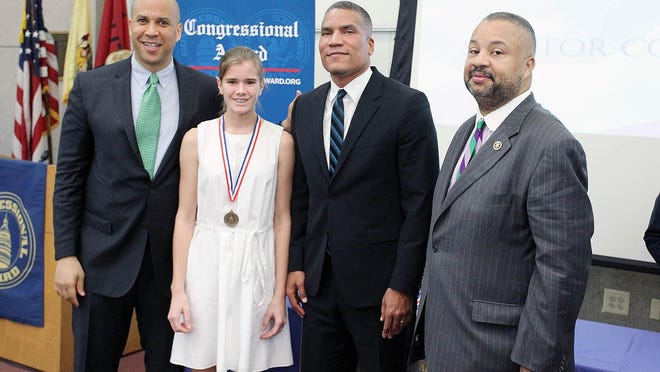 Pictured (left to right) are Senator Cory Booker, Isla Okkinga, Representative Donald Payne Jr. and Chairman of the Congressional Award Board Paxton Baker.