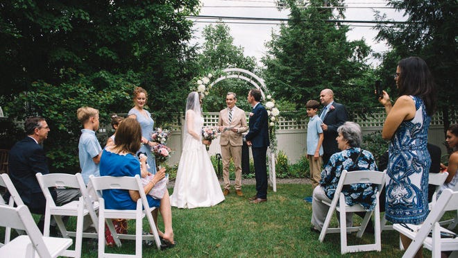 The garden at Hotel Fauchere in Milford serves as an ideal place to get married. Pictured is the mayor of Milford, Sean Strub, who also owns the property.