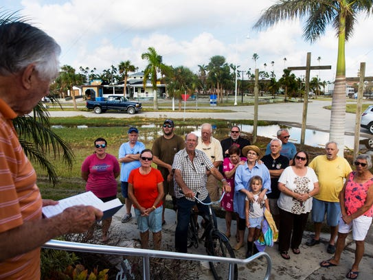 Residents of Everglades City sing together during a