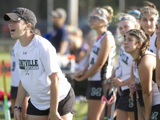 Montville field hockey coach Aimee Vizzuso directs her team from the sidelines against Mendham on Sept. 7.