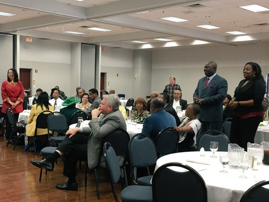 The Joe S. Green Leadership Institute and attorney Mike Johnso honor African-American faculty and staff at Louisiana College (standing) at a Black History Month luncheon Friday.