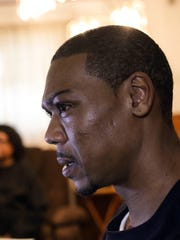 Aaron Stinson, 39, of Flint, Mich., talks Feb. 16,