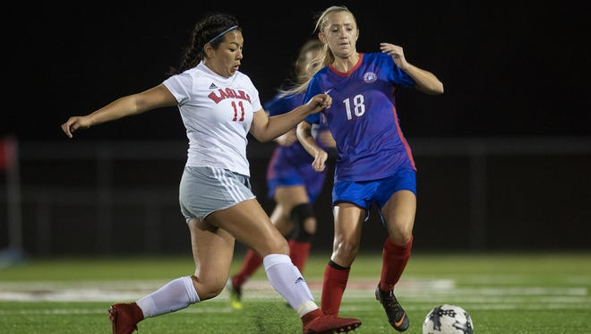 Gregory-Portland Rayven Folse and Veterans Memorial's Audrey Medina fight for ball during the District 30-5A championship game at Cabaniss Soccer Field on Friday, Match 23, 2018.