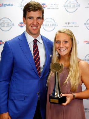 Girls Soccer Player of the Year Frankie Tagliaferri from Colts Neck poses with NY Giants quarterback Eli Manning during the Jersey Shore Sports Awards dinner at Monmouth University Monday, June 13, 2016.