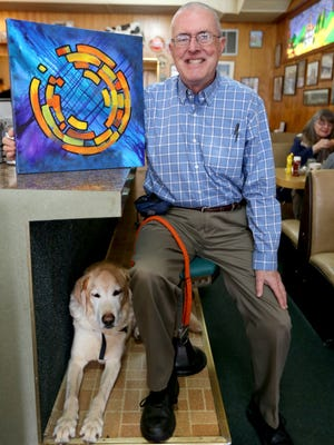 Local artist John Eells' work is on display at Roy John jewelry store in Salem through the end of the month. His hearing dog Patch joined him for Holding Court on Tuesday, Jan. 5, at Court Street Dairy Lunch.