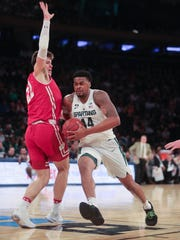 Michigan State forward Nick Ward drives against Wisconsin