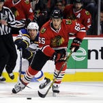 Chciago Blackhawks center Andrew Shaw skates with the puck during the first period in Game 4 during the first round of the Stanley Cup Playoffs at United Center.
