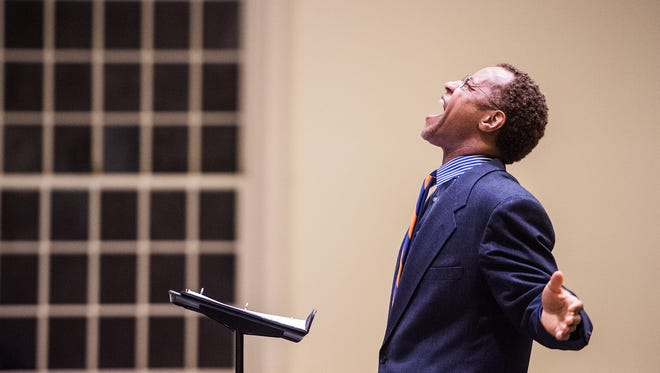 """Morgan State University Choir Director Eric Conway leads the choir in a musical arrangement of Dr. King's famous speech, """"I Have a Dream"""" on Jan. 19, 2015 at Christ Chapel on the Gettysburg College campus. Several hundred people filled the lower floor of the chapel, giving Morgan State's musical performance several standing ovations. Keynote speaker Jay Smooth opened his speech by paying tribute to the choir's abilities. """"This is the first time I've cried before a talk,"""" he said as he took the podium. Smooth used humor to illustrate his points, taking the audience from King's Selma days to the """"Black Lives Matter"""" protests of today. """"The real challenge now is how we get from legal equality to true equality,"""" he said. Clare Becker - The Evening Sun"""