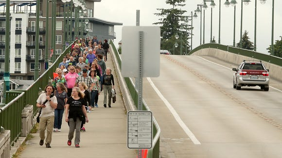 Bridging Bremerton participants cross the Manette Bridge during the 10:30am walk on Saturday, June 23, 2018.