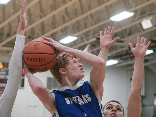 St. Peter's Kyle Osgar goes up in traffic for a shot