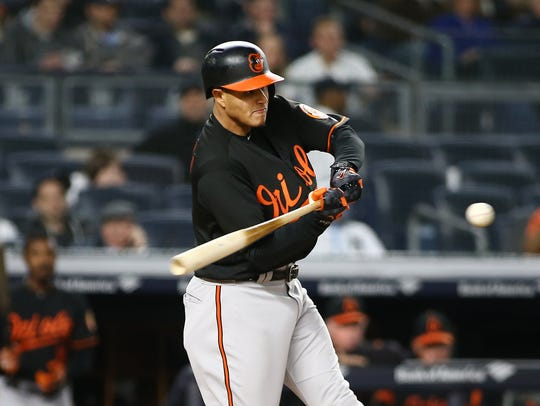 Baltimore Orioles shortstop Manny Machado (13) hits
