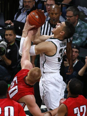 Michigan State's Gavin Schilling, right, is fouled by St. Cloud State's James Fort during the Spartans' Nov. 7 exhibition.