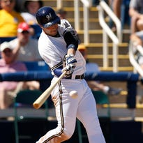 Ryan Braun hits an RBI double during a spring training baseball game earlier this spring. The Brewers are looking for more consistency at the plate.