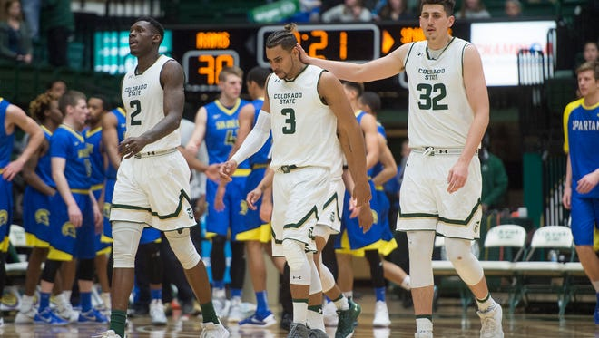 CSU guard Gian Clavell, who scored 24 points, gets a pat on the back from teammate Nico Carvacho during Wednesday night's win over San Jose State at Moby Arena. The Rams, like every other team in the Mountain West, know the only path to the NCAA tournament this year is to win the MW tournament.