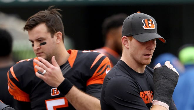 Bengals back up quarterback AJ McCarron, left, was put after Andy Dalton injured his thumb against the Steelers at Paul Brown Stadium Sunday December 13, 2015.
